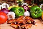 Chicken wings with vegetables — Stock Photo