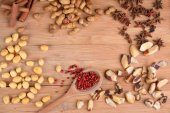 Nuts and pink peppercorn — Stock Photo