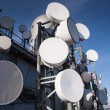 Tower with many satellite dishes — Stock Photo #70252691
