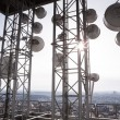 Tower with many satellite dishes — Stock Photo #70252697