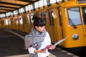 Woman standing on train station — Stock Photo