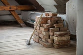 Bricks and  hammer in house — Stock Photo