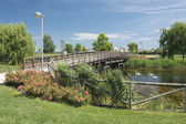 Italy, Caorle rest area with a pond and a bridge. Most popoular tourist destination on adriatic coast. — Stock Photo