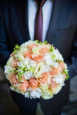 The groom in a suit or Young girl-bride or bridesmaid is holding a wedding bouquet — Stock Photo