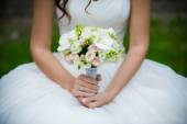 The groom in a suit or Young girl-bride or bridesmaid is holding a wedding bouquet — ストック写真