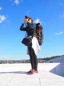 Photographer girl, stand and take photo, blue sky — Stock Photo
