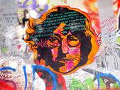 PRAGUE, CZECHIA - SEPTEMBER 25: John Lennon Wall on September 25, 2014 in Prague. Since the 80s the wall has been filled with John Lennon graffiti and John Lennon inspired lyrics from Beatles songs — Stock Photo