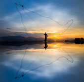 Throwing fishing silhouette — Stock Photo