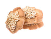 Three cookies with seeds, isolated on a white — Stock Photo