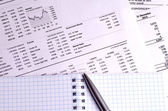Stock quotes and charts on paper — Stock Photo