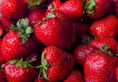 Background from freshly harvested strawberries, directly above — Stock Photo