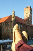 Female feet with Old Town Hall at the background. — Stock Photo