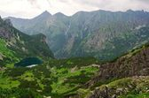 Lake in summer mountains. — Stock Photo