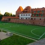 Soccer field in old town in Torun, Poland. — Stock Photo #73327431