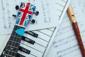 Ukulele, recorder and piano keys — Stock Photo