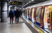 Passengers boarding London Underground train — Stock Photo