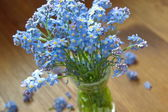 Forget me nots in the vase — Stock Photo