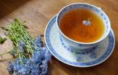 Old china tea cup with bouquet of forget me nots — Stock Photo