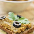 Squash caviar with olives, parsley and rye bread — Stock Photo #70311971