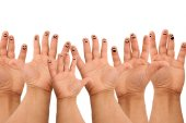 Hands with happy faces — Stock Photo