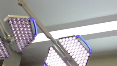 CLOSE UP-DOLLY IN. Surgical lights in a OR. — Stock Video