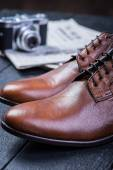 Brown leather shoes on black floor — Stock Photo