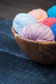 Colorful knitting yarn balls in basket — Stock Photo