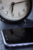 Black alarm clock with cell phone on a wooden table — Stock Photo