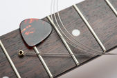 Guitar frets with string and mediator — Stock Photo