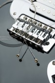 Electric guitar bridge with strings — Stock Photo