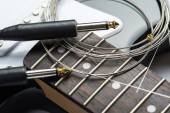 Guitar frets with strings, cable and jacks — Stock Photo