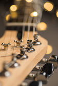 Guitar frets with strings and lights — Stock Photo