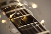 Guitar frets with mediator, strings and lights — Stock Photo