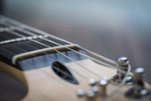 Guitar riff with strings and tuning knobs — Stock Photo