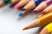 Several color pencils on a white paper sheet — Stock Photo