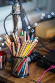 Color pencils on the table with background lights — Stock Photo