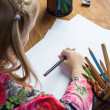 Small young girl drawing pictures with pencils — Stock Photo #71359381