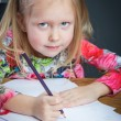 Small young girl drawing pictures with pencils — Stock Photo #71359413