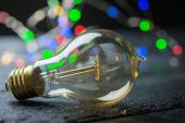 Vintage tungsten bulb with color lights — Stock Photo