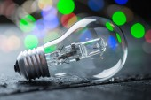 Vintage halogen bulb with color lights — Stock Photo