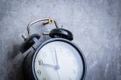 Unusual picture of vintage alarm clock hanging on the wall — Stock Photo