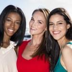 Three women posing in marina harbor, yachts on background. — Stok fotoğraf #70296807