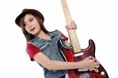 Beautiful Asian girl rocking on her guitar, on white background — Stock Photo