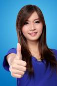 Beautiful Asian woman with thumb up gesture — Stock Photo