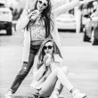 Hipster girlfriends taking a selfie in urban city context - Concept of friendship and fun with new trends and technology - Best friends eternalizing the moment with camera — Stock Photo #72870045