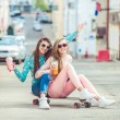 Hipster girlfriends taking a selfie in urban city context - Concept of friendship and fun with new trends and technology - Best friends eternalizing the moment with camera — Stock Photo #72870901