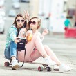 Hipster girlfriends taking a selfie in urban city context - Concept of friendship and fun with new trends and technology - Best friends eternalizing the moment with camera — Stock Photo #72893649