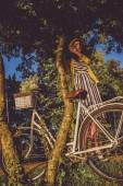 Girl on a bike ride with a retro hipster bike — Stock Photo
