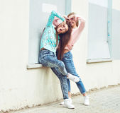 Two girlfriends are hugging and having fun — Stock Photo