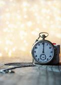 Pocket watch with bokeh background — Stock Photo